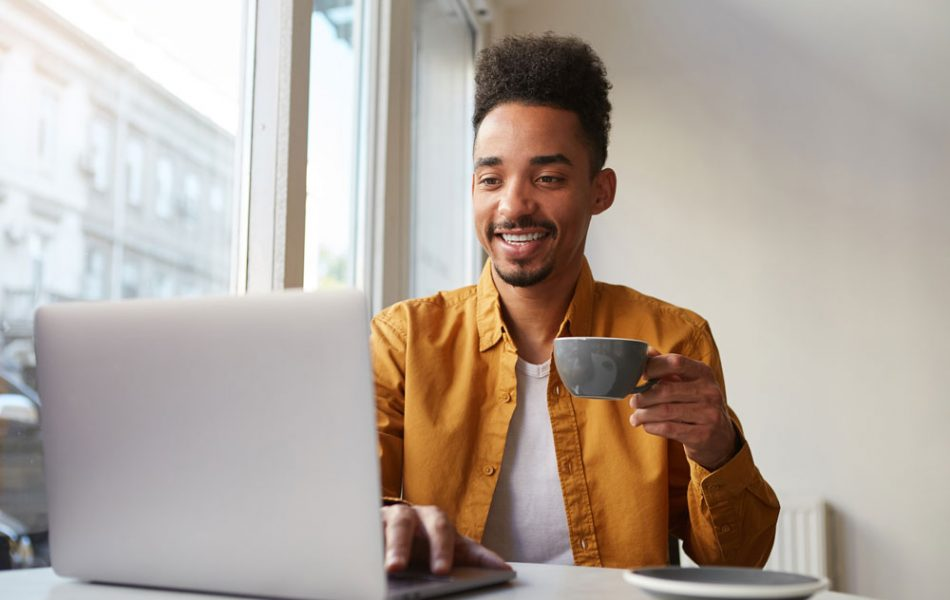 african-american-guy-sitting-table-cafe-working-laptop-wears-yellow-shirt-drinks-aromatic-coffee-chatting-with-his-girlfriend-enjoys-day